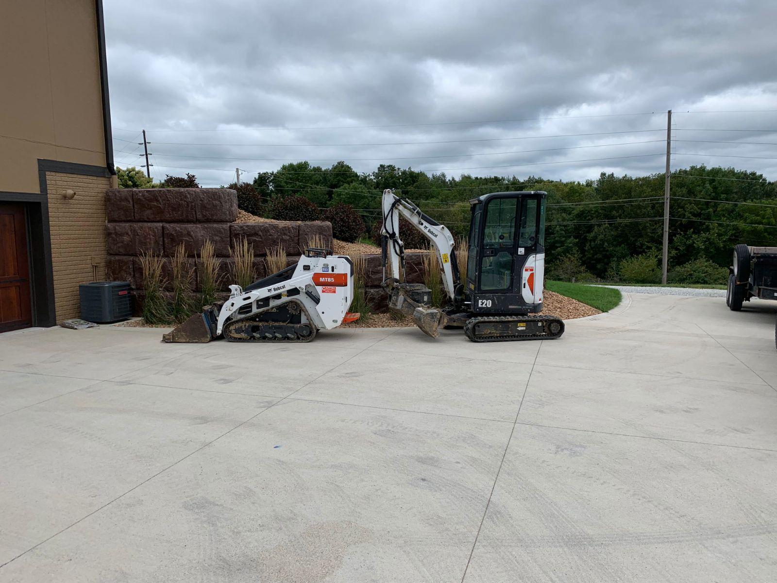 Excavator and Skid Loader